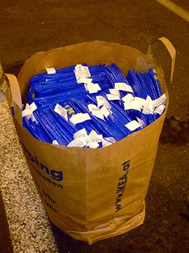 100 ikea plastic bags in an ikea paper bag
