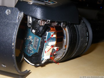 step 5: when you remove the white power connector from its shoe (1), your lens is completely disconnected from the rest of the body. if you plan to remove the flash, disconnect the three ribbon cables (2-4).