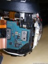 still step 6: different perspective, showing the right screw (2) and the ribbon cable (3) to be removed..