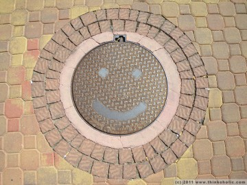 a very happy manhole, at denia marina