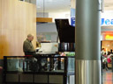 piano player at auckland airport. 2006-01-09, Sony DSC-F717.