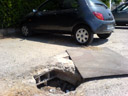 now that's what i call a pothole - on a supermarket parking lot. 2006-08-01, SonyEricsson K750i.