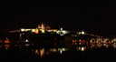 panorama: prague castle and charles bridge at night