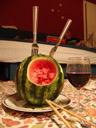a bowl of soup and cutlery, carved into a water melon. unfortunately, you can't really see the fork and knife. (who needs a spoon, anyway?). 2007-06-06, Sony F828.