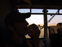 christian, using the bus' intercom. 2007-09-05, Sony F828.