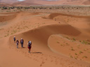 walking through the dunes of sossusvlei, at noon