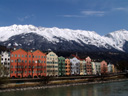 row of houses in mariahilf with snowy mountain background