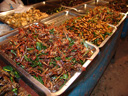 fried grasshoppers at a night market in koh samui, thailand
