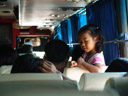little girl in the regional bus. note the karaoke tv-screen in the far left.. 2008-09-02, Sony F828.