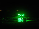 fishing boat with fishing light attractor (green lights). 2008-09-05, Pentax W60.