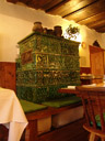 traditional tile stove in the breakfast room, br&auml;u-gasthof lobisser