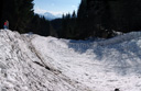 panorama: avalanche field and two kids for scale