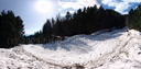 panorama: avalanche field and hikers for scale