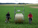 anton, giant hay bale bike and i. 2009-07-17, Pentax W60.