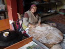 a turkish woman preparing flatbread. 2010-02-11, Sony F828.