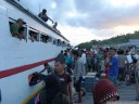 arrival of the public boat at pulau malenge, togean islands.