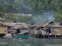 malenge village. the rising smoke hints at food preparations for the end of ramadan, id-ul-fitr