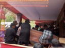the coffins are taken from the house to a place overlooking the sacrifice site (torajan funeral ceremony)