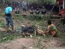 the pig's hair is burned off (torajan funeral ceremony)