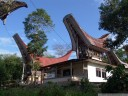 an ordinary house with tongkonan extension. (near buntao, sulawesi)