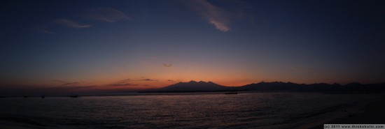 panorama: approaching dawn on gili meno, with a view of gunung rinjani (volcano & lombok's highest point)