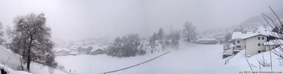 panorama: a different view - thaur during strong winter snowfall