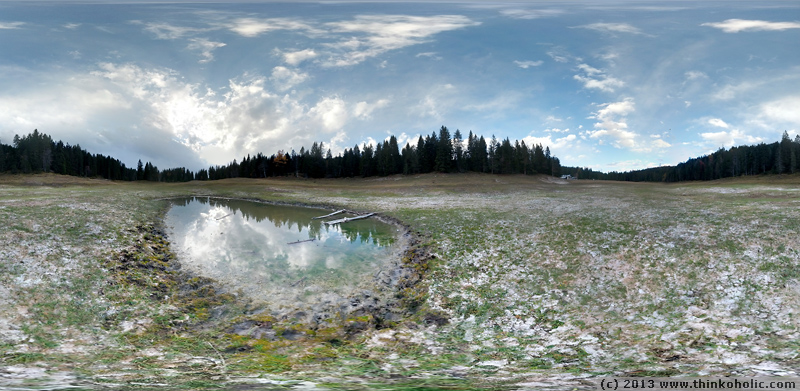 panorama: wildmoossee near seefeld, austria, is a periodic lake that only fills up every 3-4 years. here's the season's last remaining water at the very base of the basin.