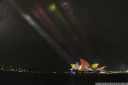 sydney opera house illuminated in the koori (aboriginal) colours