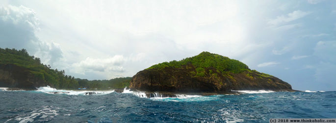 panorama: the boat entrance (left third) to apolima island, samoa